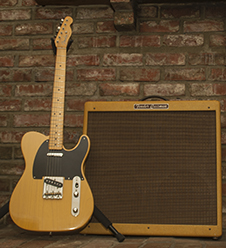 Photo of a Fender Telecaster guitar and a Fender Bassman amplifier.